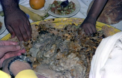 Saudi Arabia Arab Men at Dinner Goat Grab