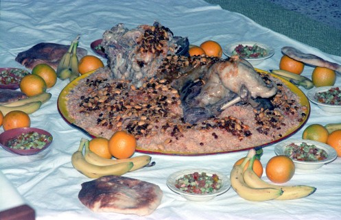 Saudia Arabia feast of roast lamb, rice, raisins, seeds, etc.